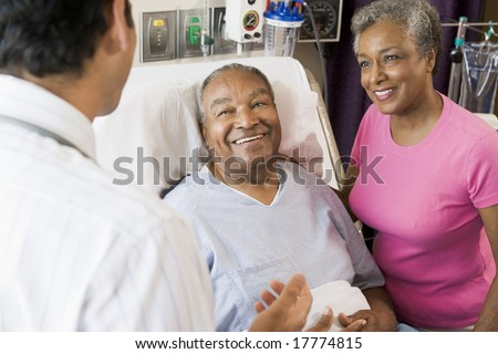 Senior Couple Talking,Smiling With Doctor - stock photo