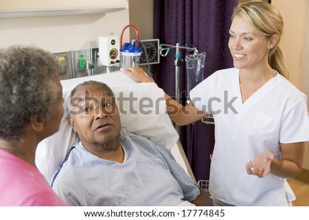 Senior Couple Talking To Doctor - stock photo
