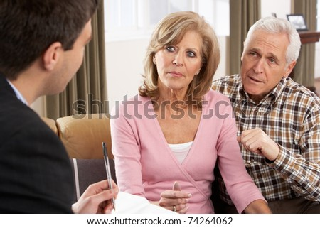 Senior Couple Talking With Financial Advisor - stock photo
