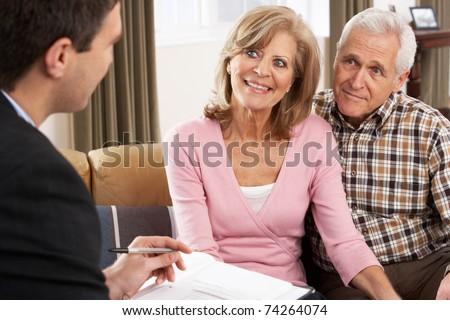 Senior Couple Talking With Financial Advisor - stock photo