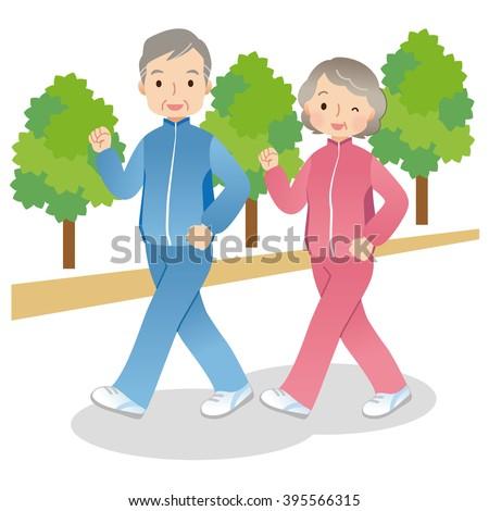 senior couple to the Walking with park - stock photo