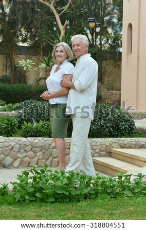 Senior couple together at tropic hotel resort