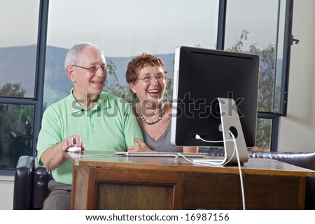 senior couple using a computer - stock photo
