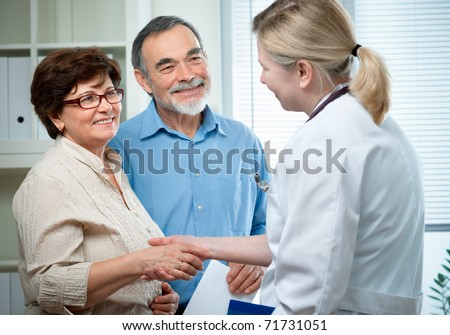 senior couple visiting a doctor - stock photo