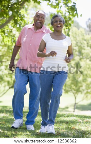 Senior couple walking together outside - stock photo