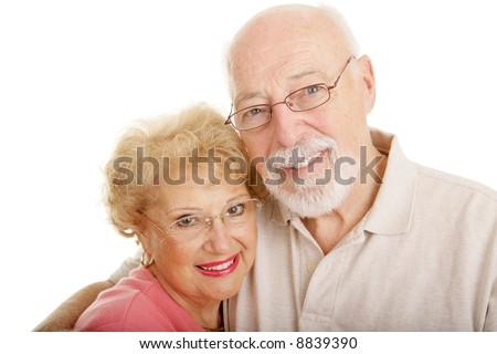 Senior couple wearing glasses.  White background. - stock photo