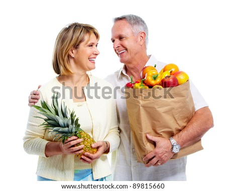 Senior couple with a grocery shopping bag. Isolated on white background. - stock photo
