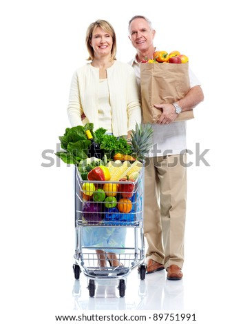 Senior couple with a grocery shopping cart. Isolated on white background. - stock photo