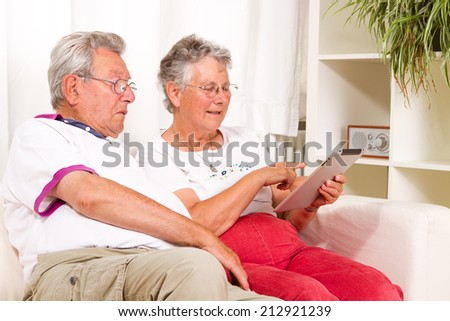 senior couple with a tablet computer  - stock photo