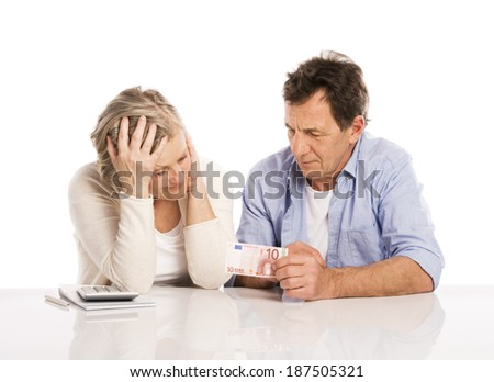 Senior couple with empty wallet discussing financial issues, isolated on white background - stock photo