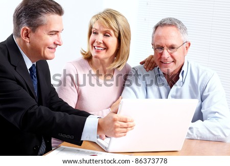 Senior couple with financial adviser. In modern office.