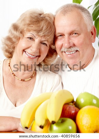 Senior couple with fresh fruits.