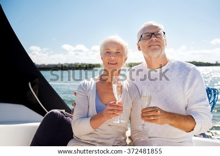 senior couple with glasses on sail boat or yacht - stock photo
