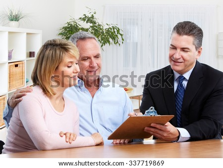 Senior couple with real estate agent in modern apartment.