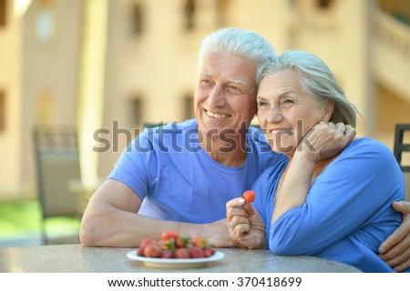 Senior couple  with strawberries - stock photo