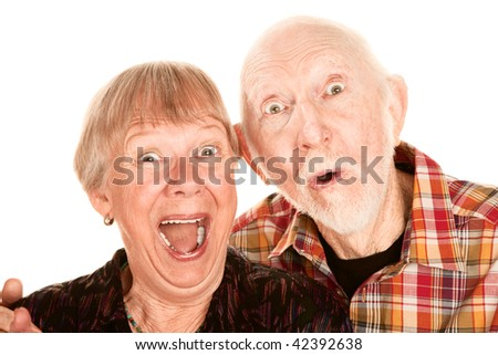 Senior couple with surprised and happy expressions