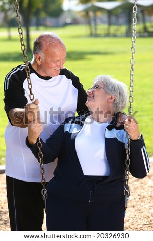 Senior couple with swing