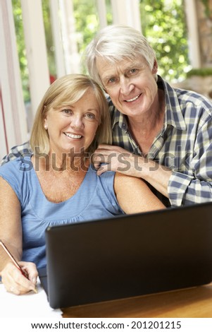 Senior Couple Working In Home Office - stock photo