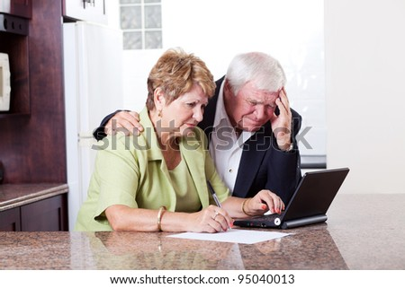 senior couple worrying about their money situation - stock photo
