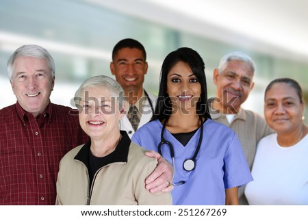 Senior couples with their medical workers in a hospital - stock photo