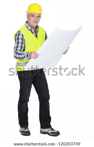 senior craftsman holding a blueprint - stock photo
