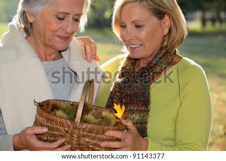 senior dames back from ramble through nature - stock photo