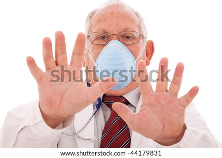 senior doctor alerting you with a protection mask - stock photo