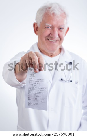 Senior doctor and bill for an anpointment in his clinic - stock photo