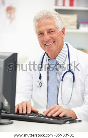 Senior doctor at desk