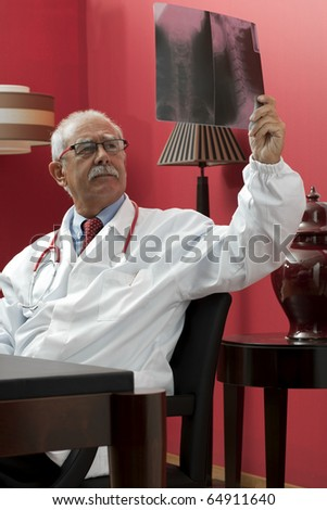 Senior doctor examining x-ray