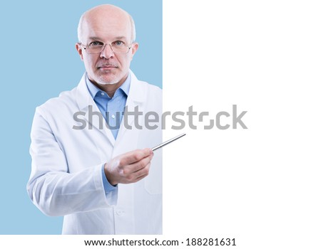 Senior doctor holding a big white sign and pointing with a pen, blank copy space. - stock photo