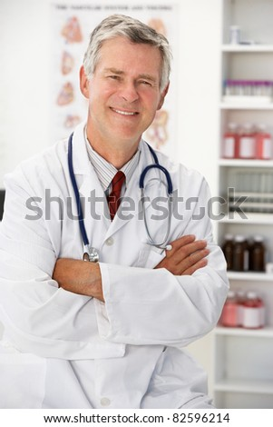 Senior doctor in consulting room - stock photo
