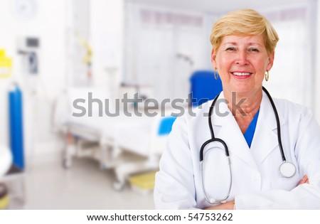senior doctor in hospital - stock photo