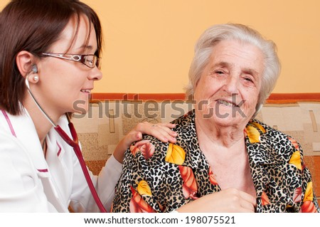 Senior doctor taking the heartbeat of his patient  - stock photo
