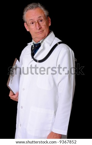 Senior doctor wearing a stethoscope isolated on black