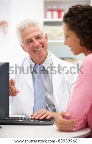 Senior doctor with female patient