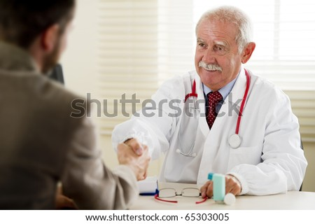Senior doctor with his patient - stock photo