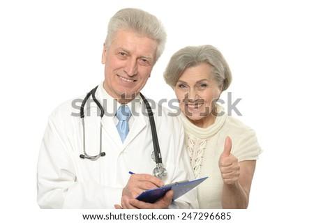 Senior doctors show thumbs up - stock photo