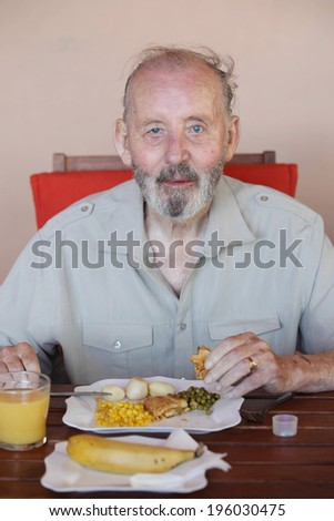 senior eating healthy meal in residential care home - stock photo