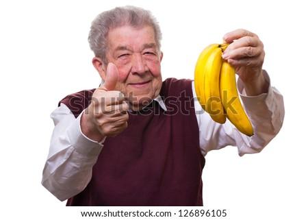 Senior eats healthy - stock photo