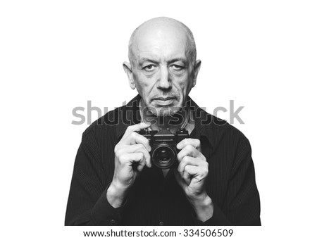 Senior, elderly man with old film camera on white background