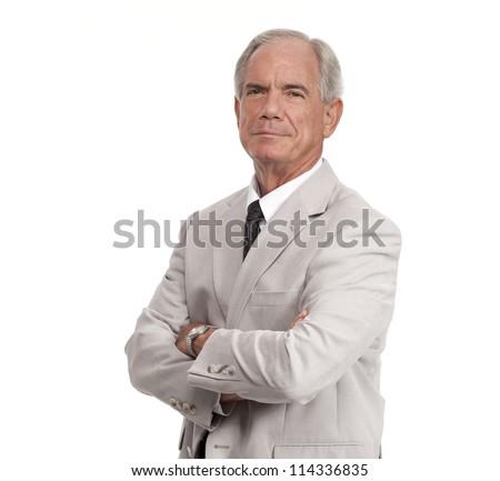 Senior Executive crosses his arms - stock photo