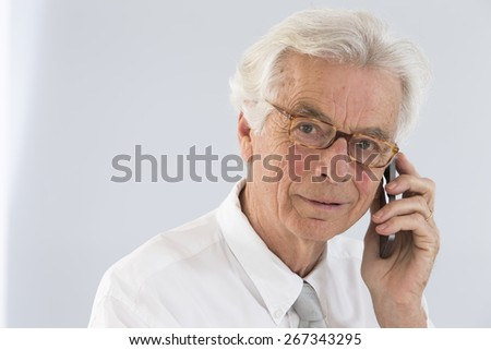 Senior  executive man talking at phone mobile - stock photo
