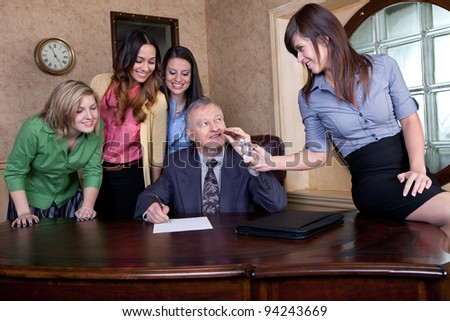 Senior executive signing a big contract with team of young women