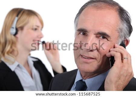 Senior executive with female assistant - stock photo