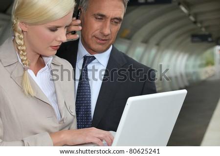 senior executive with his secretary - stock photo