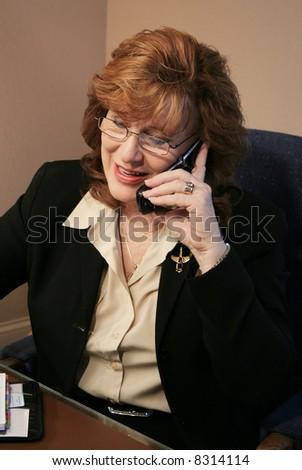 Senior Executive Woman talking on cell phone - stock photo