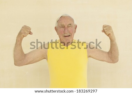 Senior exercising at gym