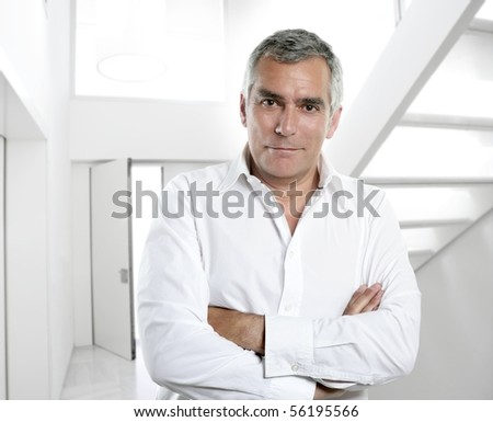 senior expertise gray hair businessman posing interior white modern office [Photo Illustration] - stock photo