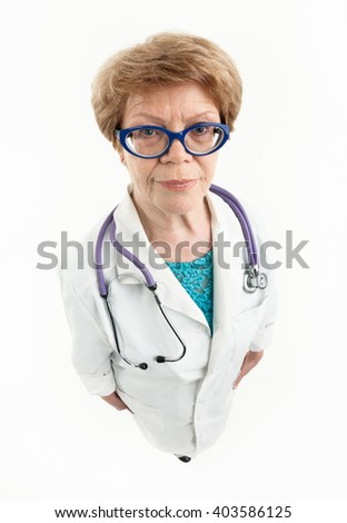 Senior female Caucasian doctor looking at the camera, wide angle, full length, white background - stock photo